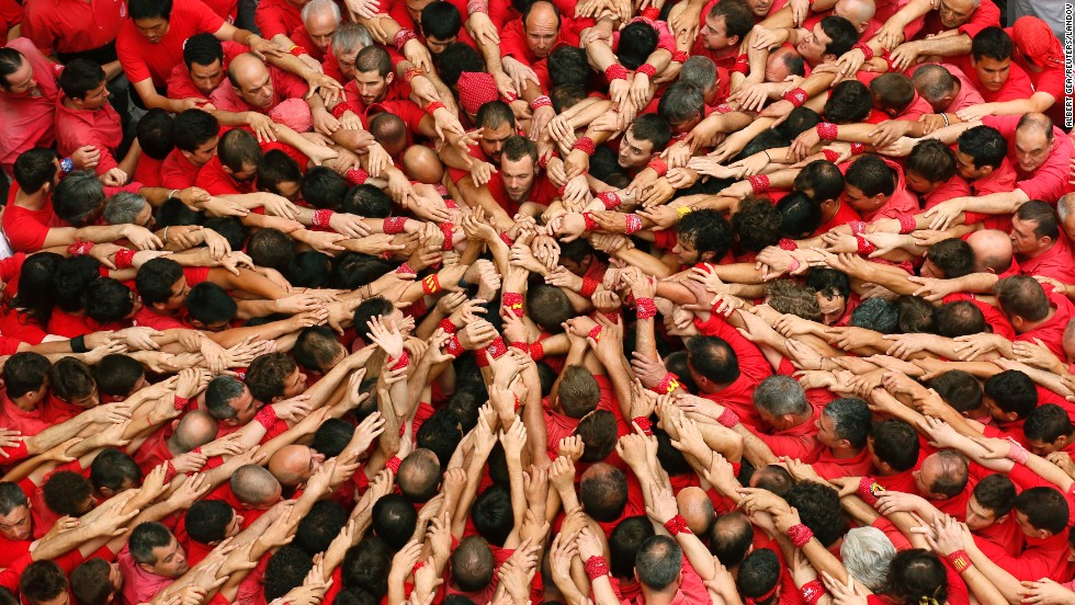 The Colla Joves Xiquets de Valls casteller group starts to form a human tower during the Saint John festival in Valls, south of Barcelona, on Tuesday, June 24.