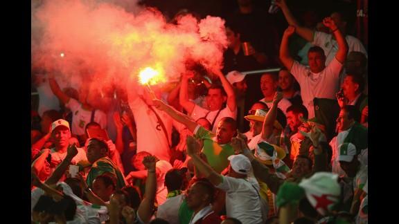 Algeria fans celebrate their team