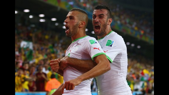 Islam Slimani of Algeria, left, celebrates scoring his team