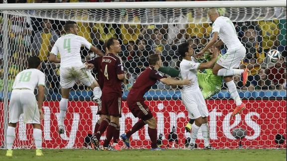 Algeria forward Islam Slimani, right, scores his team