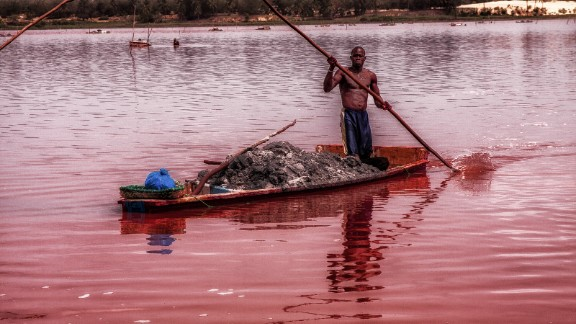 """Lake Retba, in Senegal, is known as the """"Pink Lake."""" It is becoming one of Senegal's most popular tourist destinations."""