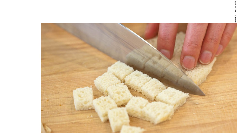 Remove crust and cut bread into rough 1/2-inch pieces (about 1/2 cup).