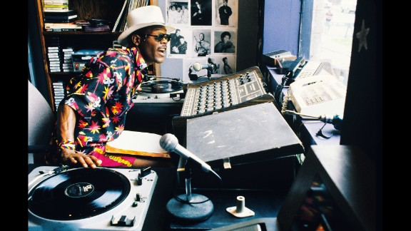"""Samuel L. Jackson plays local DJ """"Mister Senor Love Daddy,"""" whose mellifluous chatter continually comments on the day. Jackson had a major role in Lee's next film, """"Jungle Fever,"""" which proved to be his big break."""