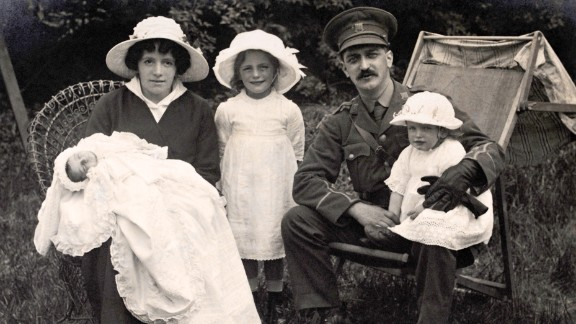 A British Army lieutenant sits in a garden with his wife and three children while on leave during the war. In Great Britain and the United States, women confronted wartime shortages of food, fuel and housing as they struggled to maintain homes and families while they also worked outside the home.