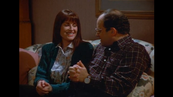 """Megan Mullally actually appeared in the same debut episode as Teri Hatcher, titled """"The Implant,"""" playing George's girlfriend Betsy. In the episode, Betsy's aunt dies and George flies to the funeral, buying an expensive plane ticket (which he hopes to later get discounted). But it all goes wrong when Betsy's brother catches George double-dipping a chip (""""I mean, you might as well put your whole mouth in the dip"""") and Betsy breaks up with George. To make matters worse, George can't get a discount on his flight because he can't give a death certificate to the airline. Four years later, TV viewers embraced Mullally as Karen Walker in """"Will & Grace."""""""