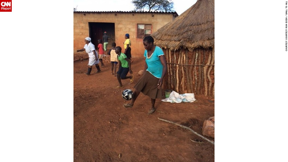 """Imagine you drive to the middle of nowhere to deliver soccer balls to kids who never had one,"" said Ron Eisen. ""After you make the delivery, a woman appears, without shoes, and has mad soccer skills!"" Eisen, a volunteer with the charity Ball To All, photographed the woman in Shangani, Zimbabwe, as she demonstrated her prowess. He <a href=""http://ireport.cnn.com/docs/DOC-1144199"">made a video</a>, too.<br />"