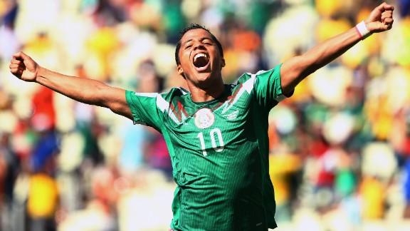 Giovani dos Santos of Mexico celebrates scoring his team's goal against the Netherlands.