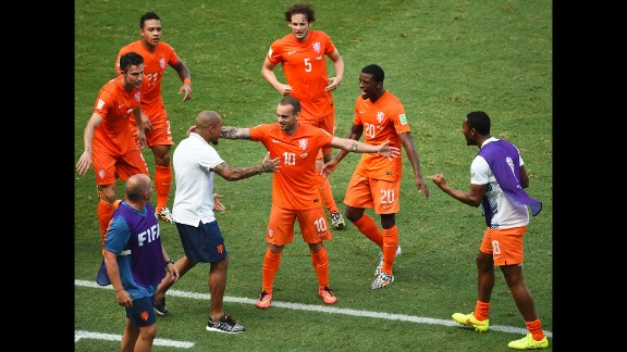 Wesley Sneijder of the Netherlands (No. 10) celebrates scoring his team's first goal against Mexico.