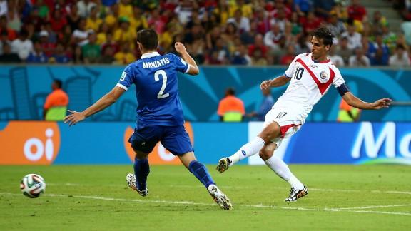 Bryan Ruiz of Costa Rica scores his team's goal against Greece.