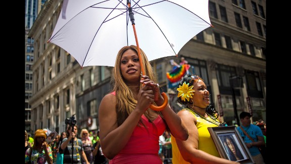 Grand Marshal Laverne Cox, left, and Delores Nettles, mother of slain transgender woman Islan Nettles, march in the parade.