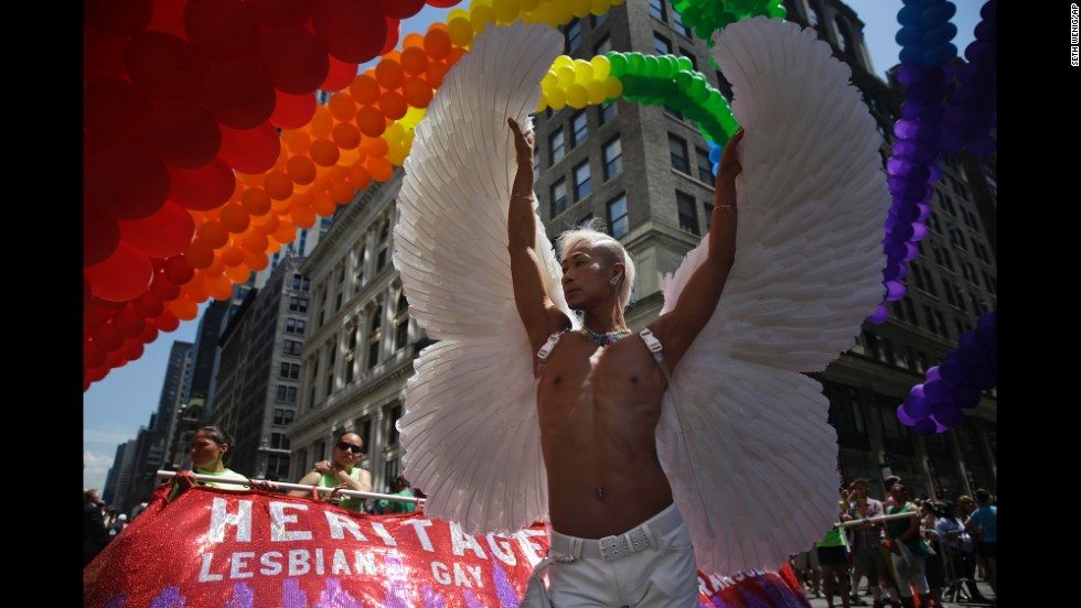 A participant poses for pictures at the start of the parade.