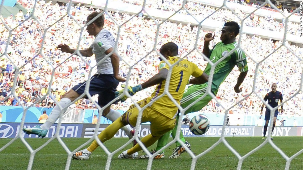 The ball hits Nigerian defender Joseph Yobo, right, before going into his own net during a World Cup match against France on June 30, in Brasilia, Brazil. France advanced to the quarterfinals with a 2-0 victory.