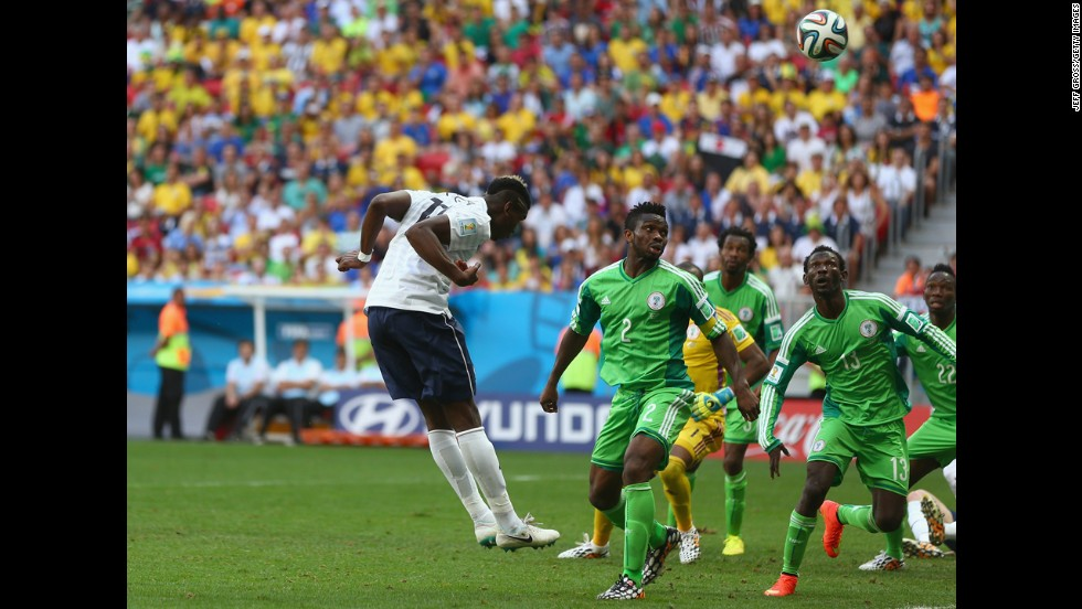 Paul Pogba of France heads in his team's first goal against Nigeria.