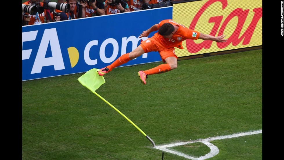 Netherlands striker Klaas-Jan Huntelaar kicks the corner flag in celebration after he scored a stoppage-time penalty kick against Mexico during a World Cup match Sunday, June 29, in Fortaleza, Brazil. It proved to be the difference as the Netherlands won 2-1 and advanced to the quarterfinals of the soccer tournament.