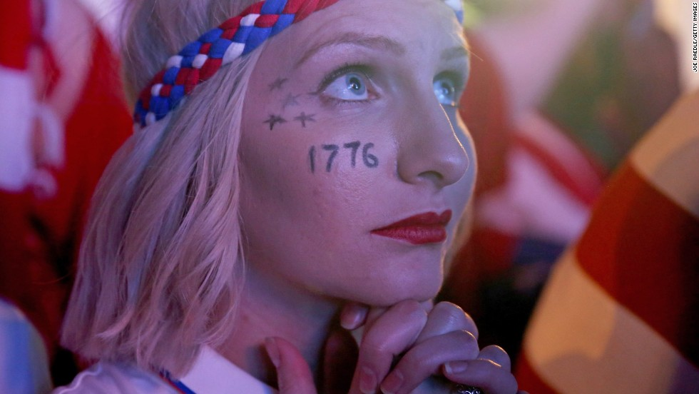A U.S. fan watches nervously as the Americans surprisingly emerge from the group stage despite a nail-biting defeat against Germany.