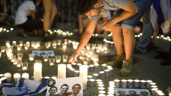 Israelis in Tel Aviv mourn the deaths of three teenagers.