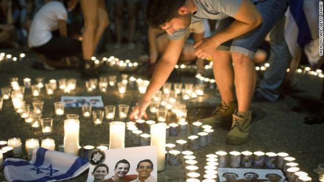 Israelis mourn and light candles in Rabin Square in Tel Aviv on June 30, 2014 after the announce that the bodies of the three missing Israeli teenagers were found. Israel confirmed finding the bodies of three teenagers who disappeared in the southern West Bank on June 12, blaming the Islamist Hamas movement for their kidnapping and murder. AFP PHOTO/OREN ZIV++ISRAEL OUT+++ (Photo credit should read OREN ZIV/AFP/Getty Images)