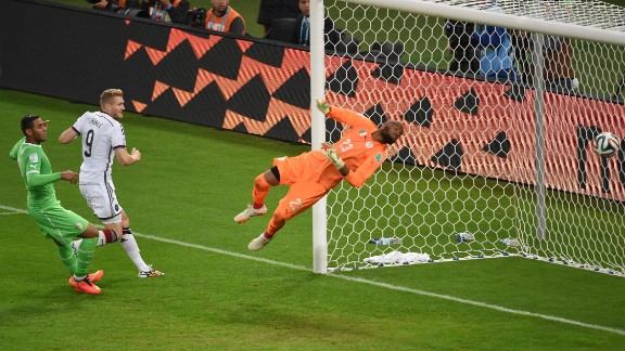 Andre Schuerrle, center, scores a backheel goal in extra time to give Germany a 1-0 lead over Algeria.