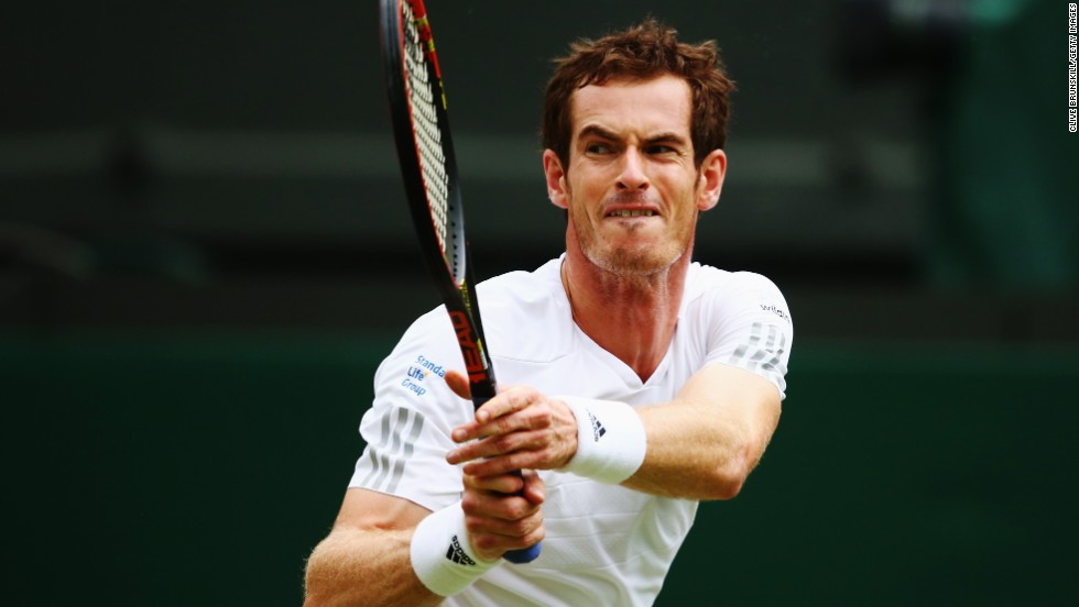 Andy Murray grimaces as he plays a backhand during his fourth round match against Kevin Anderson at Wimbledon. The defending champion won in straight sets 6-4 6-3 7-6 (8/6).
