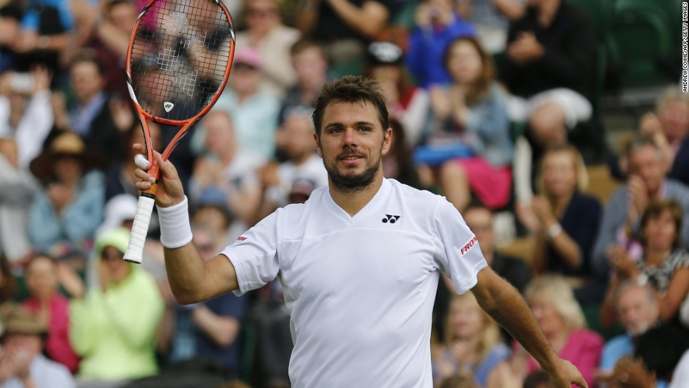 Switzerland's Stanislas Wawrinka takes the applause after wrapping up his rain-affected third round match against Uzbekistan's Denis Istomin. The reigning Australian Open champion won 6-3 6-3 6-4.