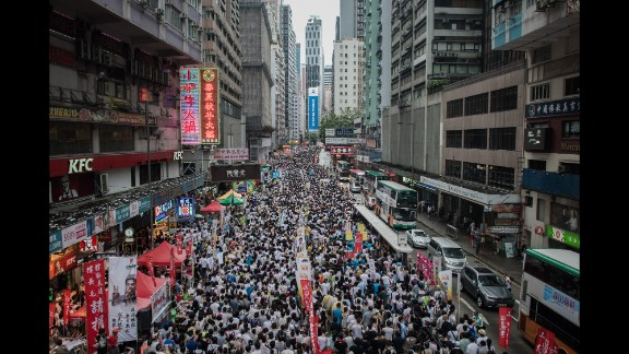 Demonstrators march during a pro-democracy rally in Hong Kong on Tuesday, July 1, as frustration grows over the influence of Beijing on the city.