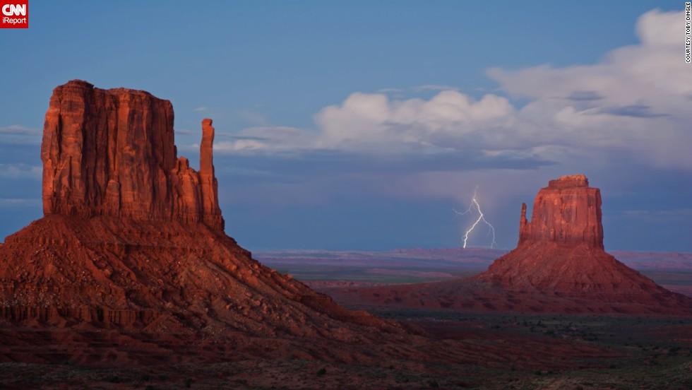 "Monument Valley on the Arizona-Utah border is known for its sandstone formations and vast desert views.<a href=""http://ireport.cnn.com/docs/DOC-1145480""> Toby Dingle</a> captured this lightning strike in September 2013. Click to see some amazing lightning photos from the past few years."