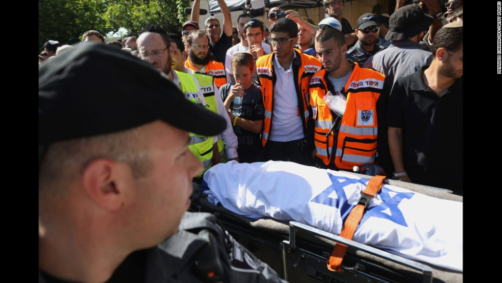 Mourners gather around the body of Gilad Shaar, 16, during his funeral ceremony July 1 in Talmon, West Bank.