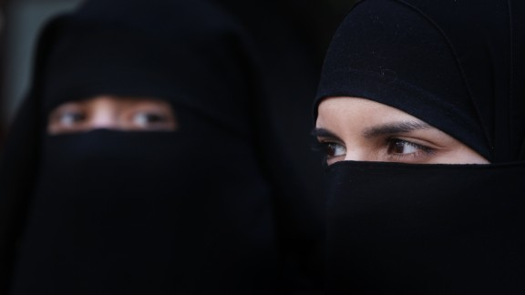 [File photo] Women wearing Islamic niqab veils stand outside the French Embassy in protest on April 11, 2011 in London, England.