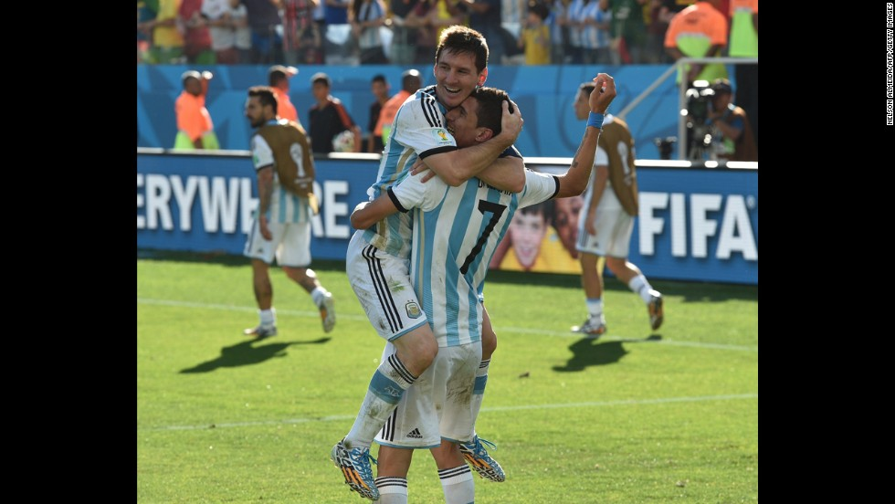 Argentina players Lionel Messi, left, and Angel Di Maria celebrate after Di Maria scored the winning goal in extra time to beat Switzerland 1-0 and advance to the World Cup quarterfinals.