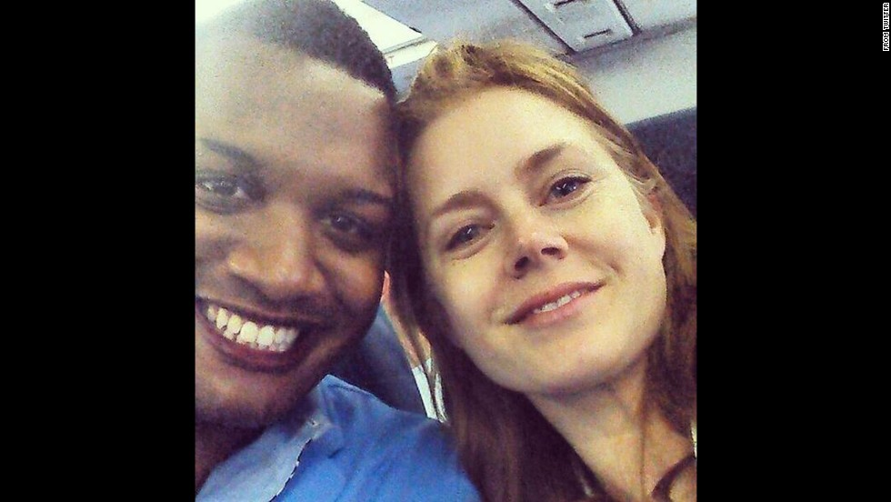"Journalist Ernest Owens <a href=""https://twitter.com/MrErnestOwens/status/482588663121858560/photo/1"" target=""_blank"">tweeted a selfie</a> with actress Amy Adams on Friday, June 27. ""Told @InsideEdition why Amy Adams was classy for giving up her 1st class seat to the soldier sitting next to me!"" he wrote."