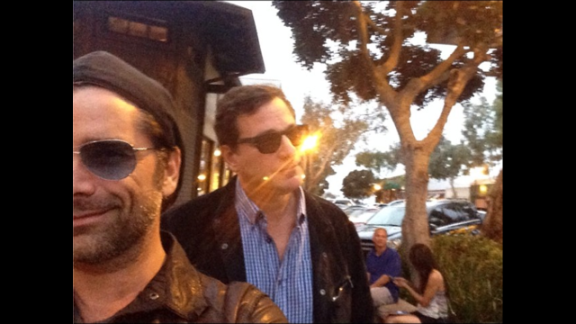 """Comedian Bob Saget, right, posted a selfie with his former """"Full House"""" co-star John Stamos on Saturday, June 28. """"Sunset Stamos selfie,"""" he wrote on Instagram."""
