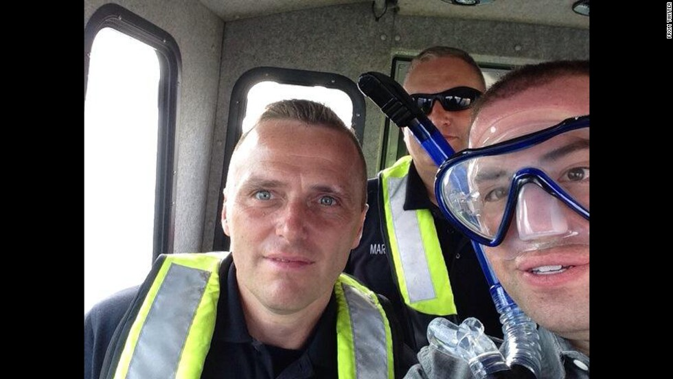 "The Baltimore Police Department <a href=""https://twitter.com/BaltimorePolice/status/482638157226078209/photo/1"" target=""_blank"">tweeted an interesting selfie</a> on Friday, June 27: ""You asked for a #selfie from our Global Police Tweet-a-thon so here it is. #poltwt #Baltimore."""