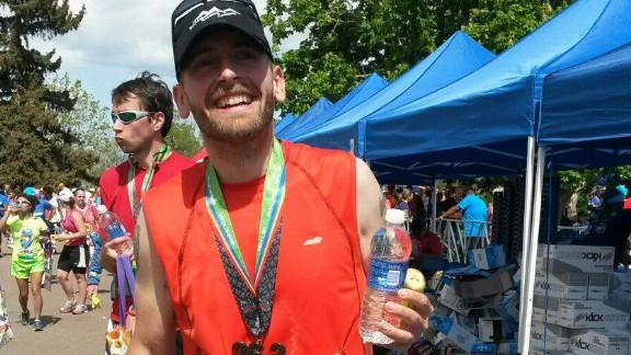 """Rob, who previously thought going for a run was """"unappealing to the point of agony,"""" completed a marathon on May 18, 2014."""