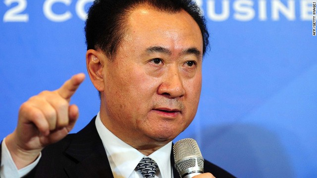 This picture taken on December 12, 2012 shows Wang Jianlin, head of conglomerate Wanda Group -- a private firm with interests ranging from property to retailing -- attending a press conference in Beijing. Wang, a multi-billionaire who bought US cinema chain AMC Entertainment and has just acquired a luxury British yacht builder, has taken top spot as China's richest man with a wealth of 14 billion USD, according to Forbes magazine. CHINA OUT AFP PHOTOSTR/AFP/Getty Images