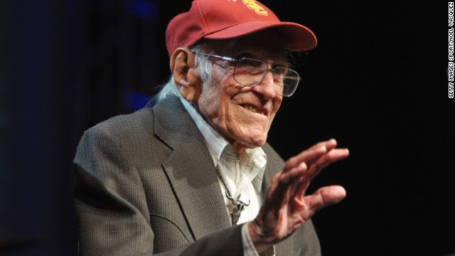 Zamperini, a University of Southern California alumnus, serves as a presenter at the Golden Goggle swimming awards in Los Angeles in 2011.