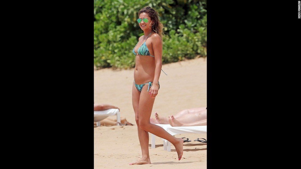 """Pretty Little Liars"" star Shay Mitchell strolled on Maui's sands in a two-piece in June 2014 ."