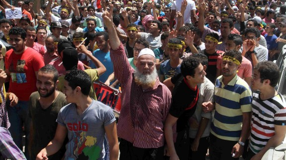 Egyptian supporters of the Muslim Brotherhood movement shout slogans during a rally to mark the first anniversary of the military ouster of president Mohamed Morsi on July 3, 2014 in Cairo