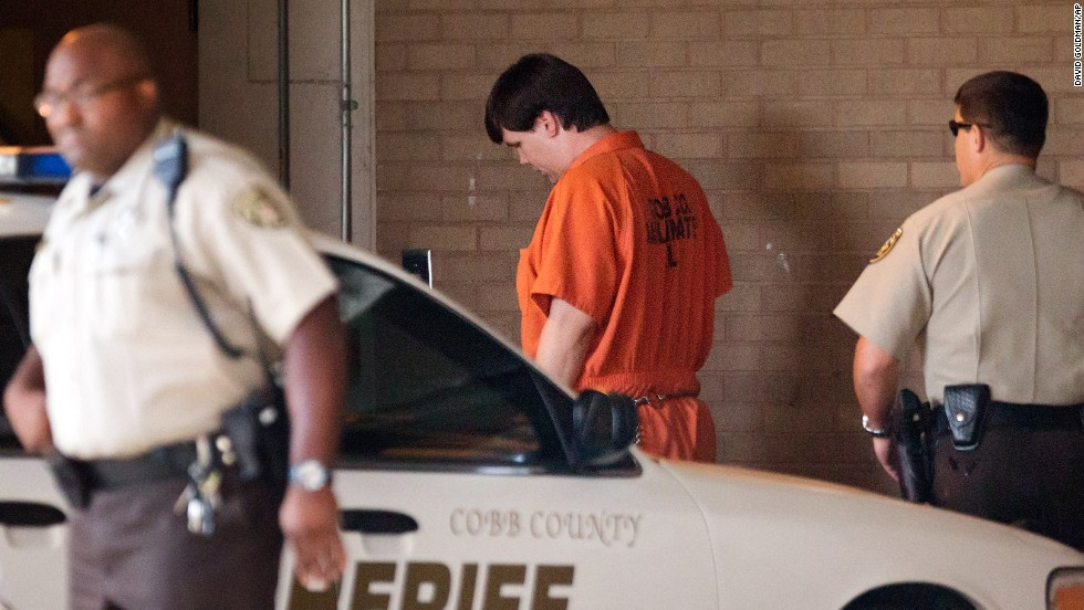 "Justin Ross Harris, center, arrives for a probable cause hearing Thursday, July 3, in Marietta, Georgia. A Cobb County judge ruled that Harris <a href=""http://www.cnn.com/2014/07/03/justice/georgia-hot-car-toddler-death/index.html"">will face murder and child cruelty charges</a> for the death of his 22-month-old son, Cooper. Police say Harris left Cooper in a hot car for seven hours while he went to work on June 18. Harris has pleaded not guilty."