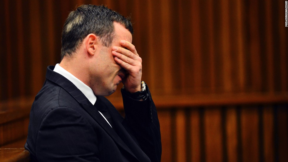 "Oscar Pistorius reacts during <a href=""http://www.cnn.com/2014/03/03/africa/gallery/pistorius-2014-trial/index.htm"">his murder trial</a> Monday, June 30, in Pretoria, South Africa. Pistorius, the first double amputee runner to compete in the Olympics, is accused of intentionally killing his girlfriend, Reeva Steenkamp, in February 2013. Pistorius has pleaded not guilty to murder and three weapons charges."