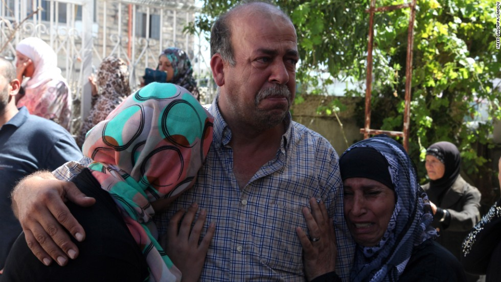 Relatives of Mohammad Abu Khedair mourn the Palestinian teenager's death Wednesday, July 2, in Jerusalem. Khedair was heading to a mosque around 4 a.m. that day when three men forced him into a car and drove off, his father said. The boy's body was found about an hour later at a forest in Jerusalem.