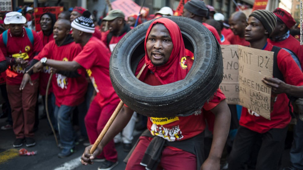 On the first day of a nationwide strike called by South Africa's National Union of Metalworkers, striking workers demonstrate Tuesday, July 1, in Johannesburg's Central Business District. The union is demanding better working conditions and a pay raise of up to 12%.