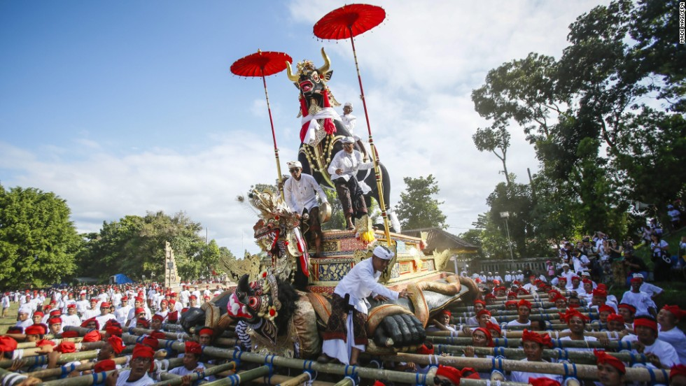A sarcophagus in the form of a bull is transported to a cemetery in Bali, Indonesia, during a grand royal cremation of Klungkung royal family member Ida Dewa Agung Istri Putra on Sunday, June 29.