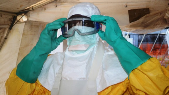 A picture taken on June 28, 2014 shows a member of Doctors Without Borders (MSF) putting on protective gear at the isolation ward of the Donka Hospital in Conakry, where people infected with the Ebola virus are being treated. The World Health Organization has warned that Ebola could spread beyond hard-hit Guinea, Liberia and Sierra Leone to neighbouring nations, but insisted that travel bans were not the answer. To date, there have been 635 cases of haemorrhagic fever in Guinea, Liberia and Sierra Leone, most confirmed as Ebola. A total of 399 people have died, 280 of them in Guinea.