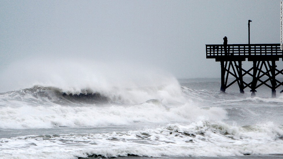 Waves kicked up by the storm are seen July 3 at the pier in Cherry Grove Beach, South Carolina.