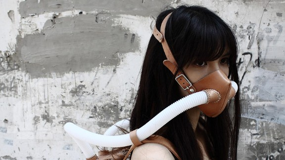 Artists have come up with their own take on the problem. Chiu Chih has designed a a bold, abstract take on an oxygen tank -- a potted plant inside a clear backpack hooked up to two tubes to funnel fresh air into a face mask.