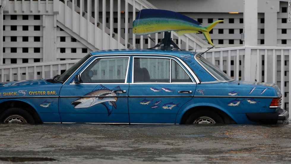A car sits in rising waters in Nags Head on July 4.