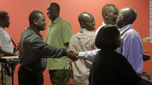 MANCHESTER, NH - MAY 25: Congregants greet each other after the service at the Sudanese Evangelical Covenant Church. (Photo by Lane Turner/The Boston Globe/Getty Images)