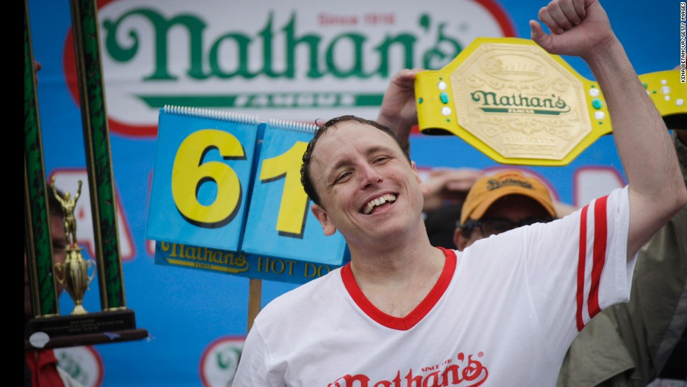 Joey Chestnut celebrates Friday, July 4, after winning the 98th annual Nathan's Famous Hot Dog Eating Contest at Coney Island in New York. Chestnut ate 61 hot dogs to win the men's competition for the eighth straight year.