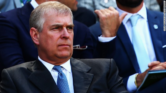 Prince Andrew watches Roger Federer take on Milos Raonic from the Royal Box at Wimbledon.
