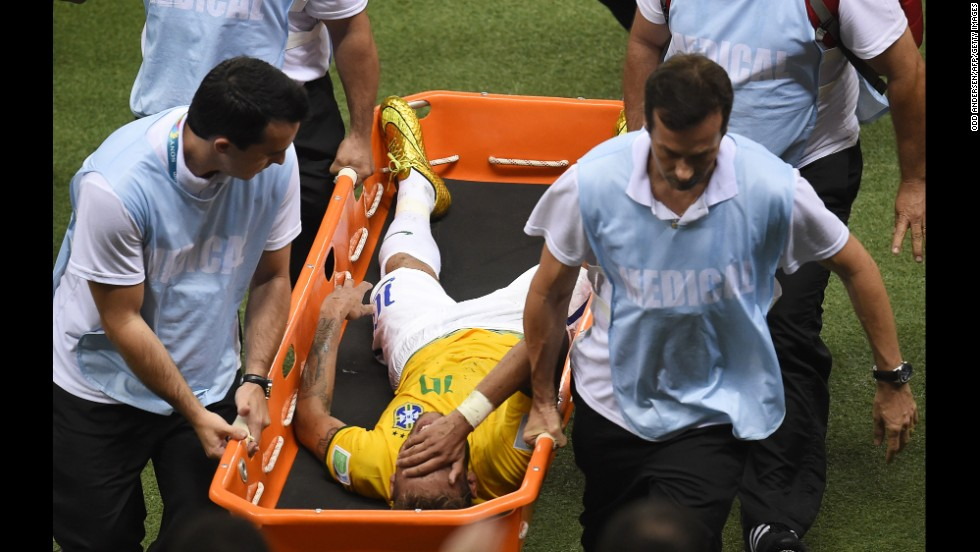 Neymar is carried on a stretcher after being injured following a tackle during the quarterfinal against Colombia at the Castelao Stadium in Fortaleza during the 2014 World Cup.